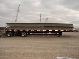 Expandable trailer with two double tees