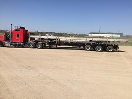 Expandable trailer with a 60' tall insulated wall p anel