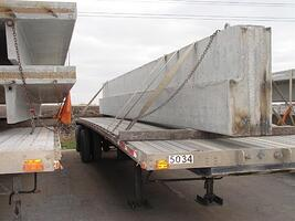Flat trailer with a beam