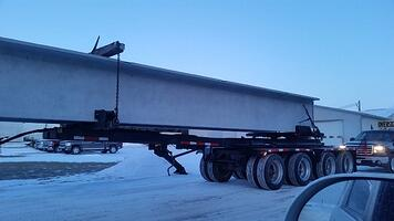 Pole trailer with 110' long double tee and safety escord